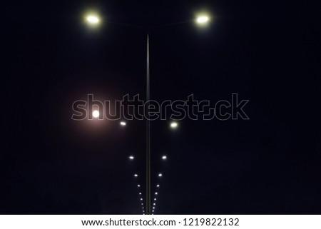 string of street light post illuminates at night, chisinau, moldova #1219822132
