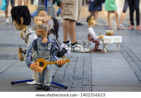 String puppets street performance on the Belgrade streets, Serbia #1402356623