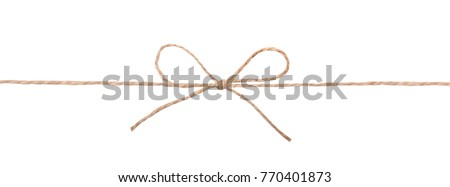 String twine rope bow isolated on white.Decoration element.Parcel tied fiber.