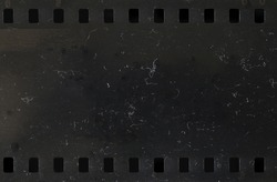 Strip of old, scratched and dusty celluloid film