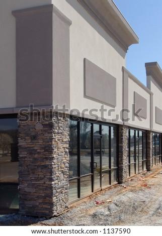 Strip shopping center under construction.