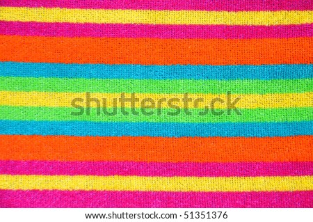 Striped beach towel useful as background texture or pattern