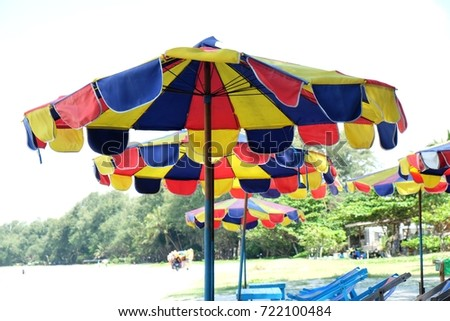 Striped beach umbrella on the beach, The color of beach umbrella #722100484