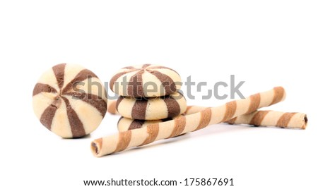 Striped chocolate wafer rolls and stake biscuits. Isolated on a white background