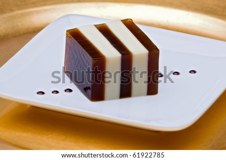 Striped Coffee And Condensed Milk Jello On White And Gold Plates ...