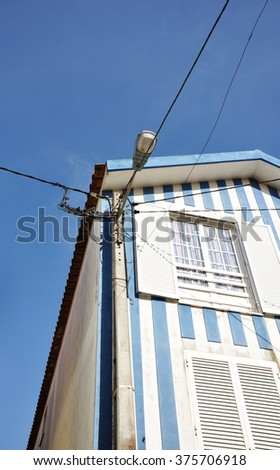 Striped house against blue sky #375706918