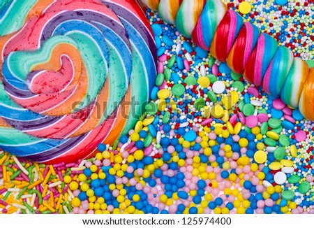 Striped lollipop and multicolored candies