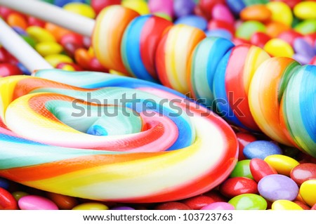 Striped lollipops and multicolored smarties