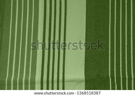 Striped pattern with stylish colors. Green and white stripes. Greenery background for design in a vertical strip #1368518387