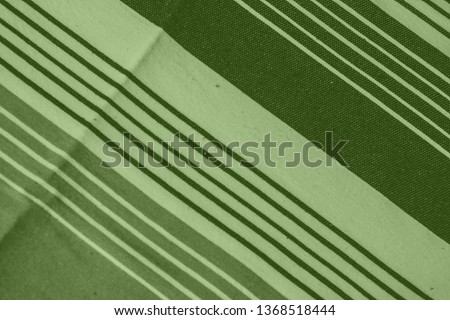 Striped pattern with stylish colors. Green and white stripes. Greenery background for design in a vertical strip #1368518444
