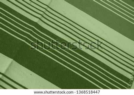 Striped pattern with stylish colors. Green and white stripes. Greenery background for design in a vertical strip #1368518447