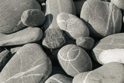 Striped sea stones. round pebbles. Pebbles