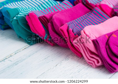 striped socks on white wood table #1206224299