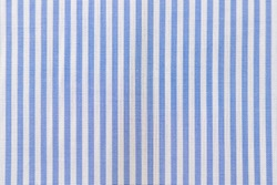 Striped textile pattern of a blue white business shirt. Fabric structure closeup of fashion clothing.