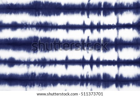 Photo of  striped tie dye pattern on cotton fabric abstract background.