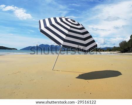 Striped umbrella on a sandy beach of Langkawi island