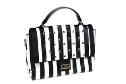 Striped women's bag isolated on white background. Female's black and white elegant purse with stripes.