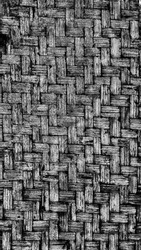 Striped woven bamboo wall in black and white with high noise and contrast, HDR processed.   Bamboo wall textures suitable for background or wallpaper.