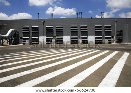 stripes leading to the industrial plant