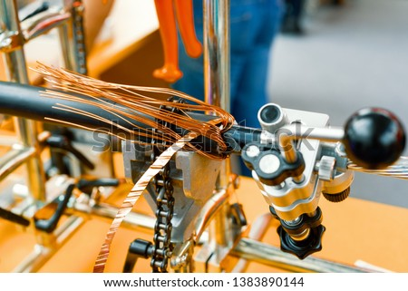 Stripping electrical cable from insulation. Mechanical stripping and cutting machine. #1383890144