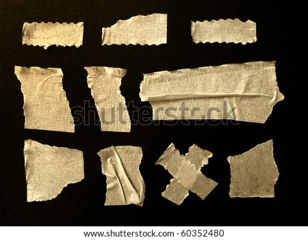 Strips of masking tape. Isolated on black