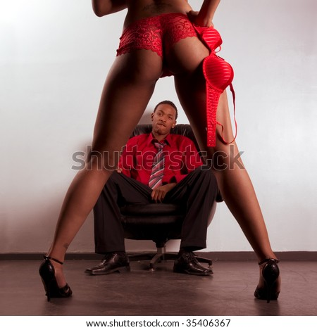 Striptease exotic dancer performing for ethnic African American business man (focus is on panties)