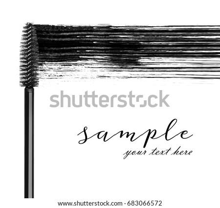 Stroke of black mascara with applicator brush close-up