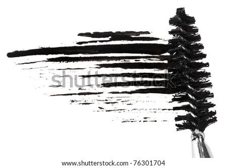 Stroke of black mascara with applicator brush, isolated on white macro
