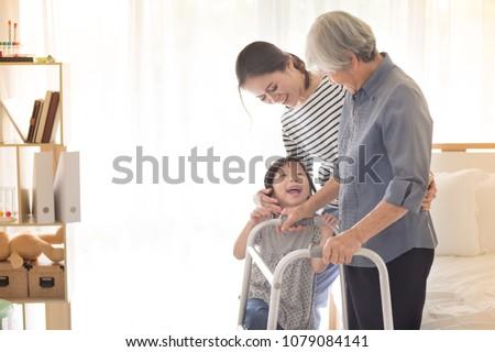 stroke patient use walker, Asian old female train use walker with family, walk training  Stockfoto ©
