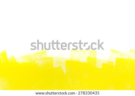 strokes of yellow paint roller on white wall