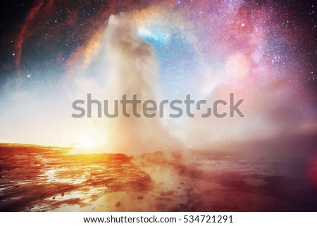 Strokkur geyser eruption in Iceland. Fantastic colors. The magical starry sky. Courtesy of NASA.