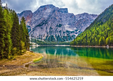 Stroll around the beautiful lake Lago di Braies. The concept of walking and eco-tourism. Travel to South Tyrol, Italy #554625259
