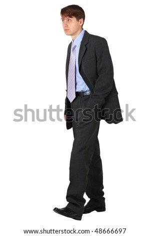 Strolling young business man on a white background