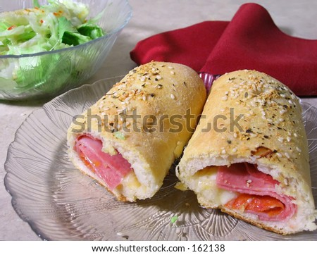 Stromboli - Italian sandwich with meat rolled in bread dough and baked