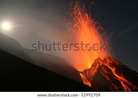 Stromboli volcano at full-moon with eruption