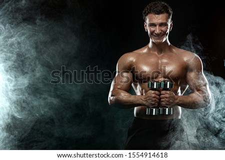Strong and fit man bodybuilder. Sporty muscular guy with dumbbells. Sport and fitness motivation. Individual sports recreation. #1554914618