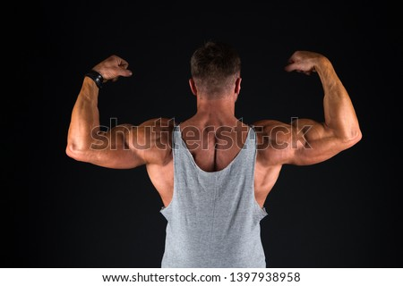 Strong athletic fitness man. Bodybuilding training. Strength and motivation. Sport achievement. Successful in sport. Stay great shape. Bodybuilding lifestyle. Mature sportsman. Bodybuilding concept.