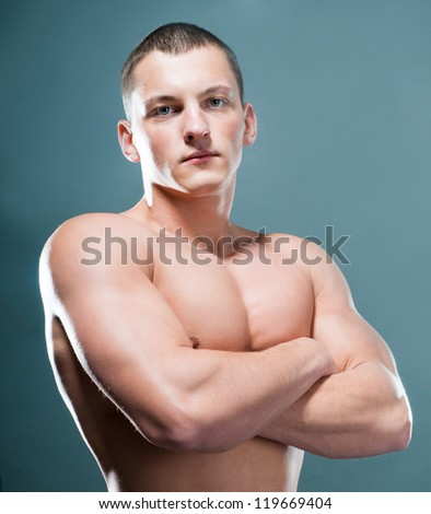 strong athletic man on grey background