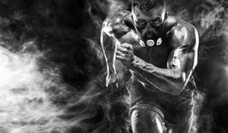 Strong athletic man sprinter in training mask, running, fitness and sport motivation. Runner concept with copy space. Dynamic movement.