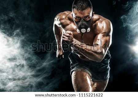 Strong athletic man sprinter in training mask, running, fitness and sport motivation. Runner concept with copy space. Dynamic movement. #1115221622
