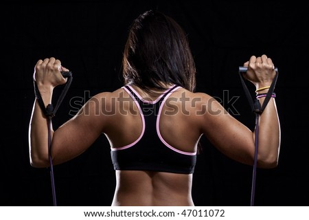 Strong Back of a Woman Exercising