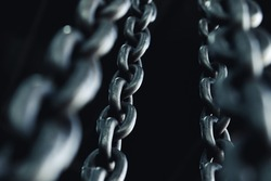 Strong brazed industrial chains on a black background.