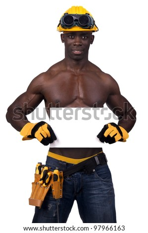 Strong build black construction worker with a white card isolated in white