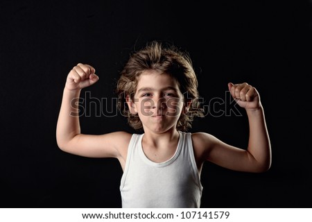 Strong Child showing his muscles