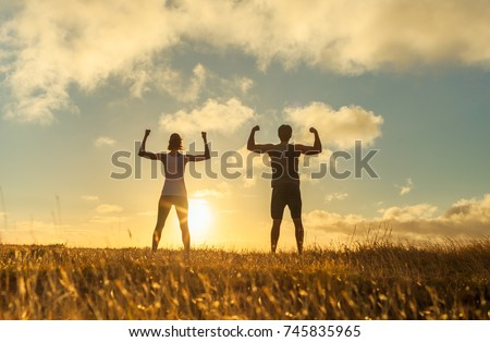Strong confident man and woman flexing.