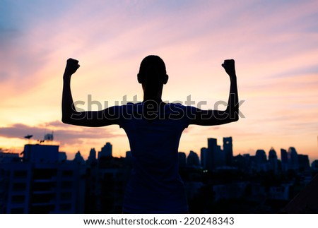 Strong confident woman in the city