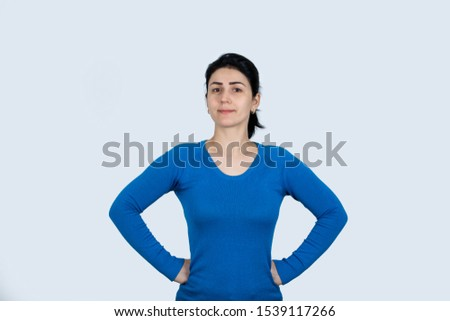Strong, determined, confident woman showing  power isolated over white background. People confidence expression, strength and motivation concept.