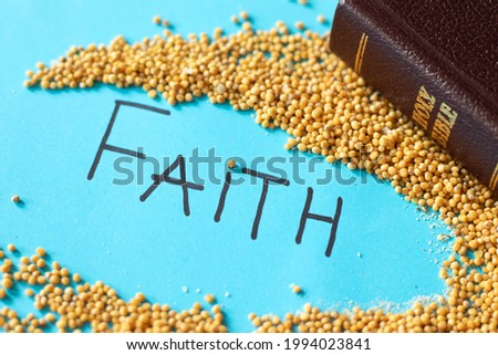 Strong faith like a mustard seed in God Jesus Christ. Parable of hope and trust. Golden Holy Bible with handwritten word text. The gospel of Matthew 17:20. Faithful Christian concept.
