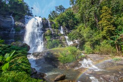 Strong flow with rain-like mist and rainbow in the spray of Vachirathan Waterfall in Doi Inthanon National Park,Chom Thong District,Chiang Mai province,Northern Thailand.