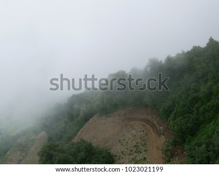 Strong fog in the mountains, thick fog, mountains in the fog #1023021199